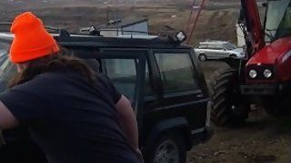 Petite jeep cherokee gets saved by Massey ferguson tractor
