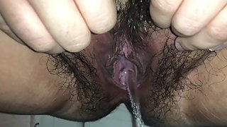 Close up piss into jar bbw