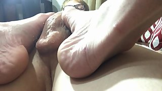 POV Lubed up footjob