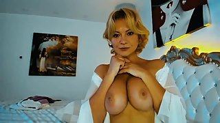 Stunning Blonde MILF Masturbating With Her Big Boobs...