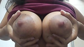 LATINA shows her BIG NATURAL TITS up close (DRIPPING MILK )