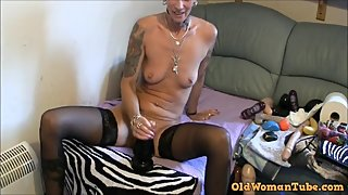 GRANDMOTHER TAKES A HUGE BLACK DILDO IN HER ASS
