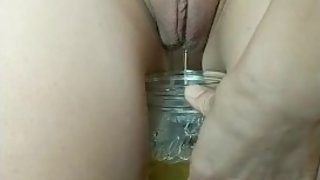 Sexy pregnant girl with bald pussy peeing in glass between legs! Drank it!